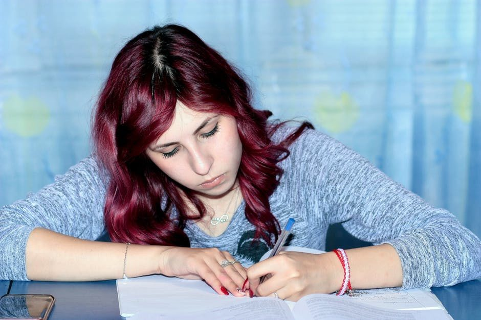 study-girl-writing-notebook-159810.jpeg